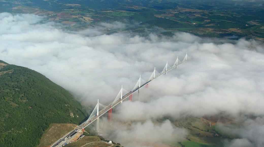 Millau showing a bridge and mist or fog