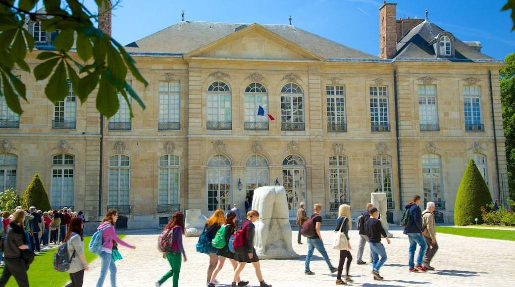 Paris featuring heritage architecture and a square or plaza as well as a large group of people
