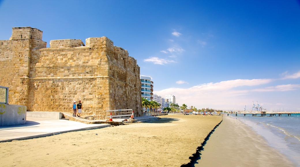 Larnaca Fort which includes a sandy beach, general coastal views and heritage architecture