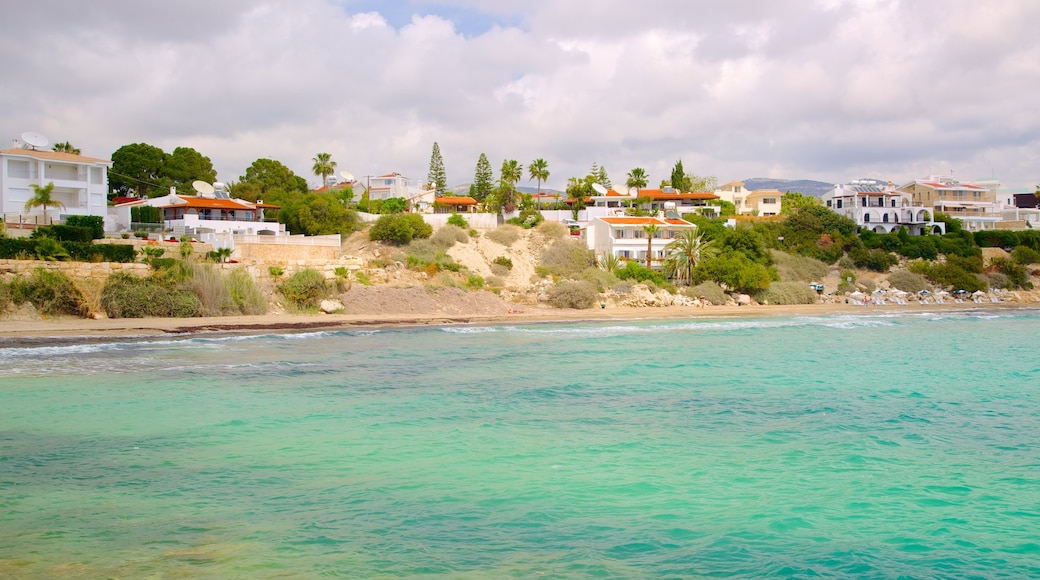 Coral Bay Beach which includes a bay or harbour, a coastal town and general coastal views