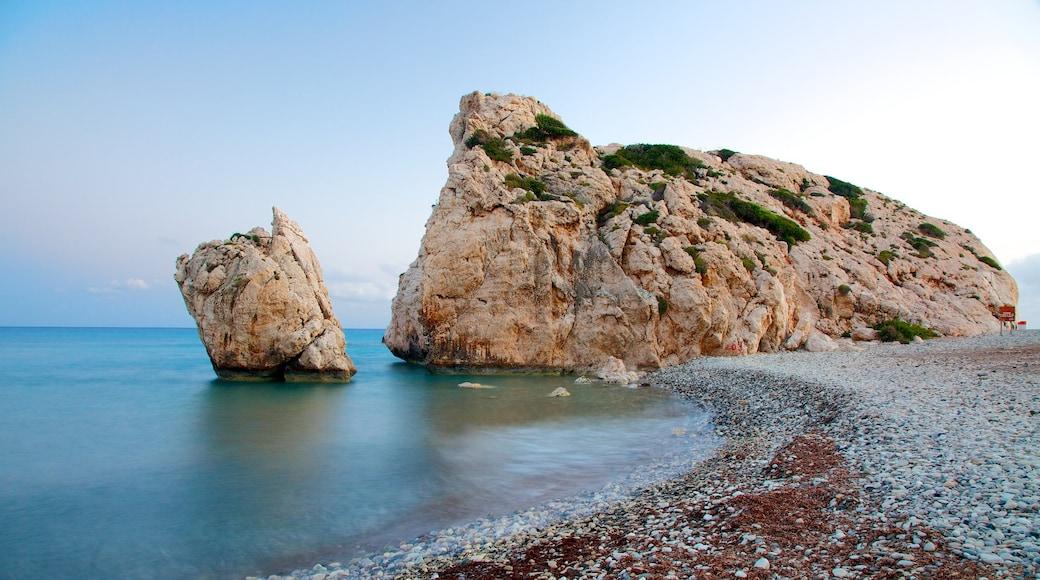 Aphrodite\'s Rock featuring a pebble beach