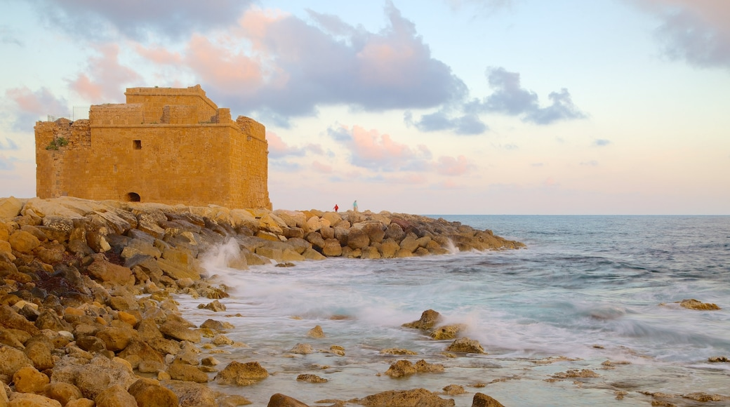 Paphos Castle featuring rocky coastline, heritage architecture and a castle