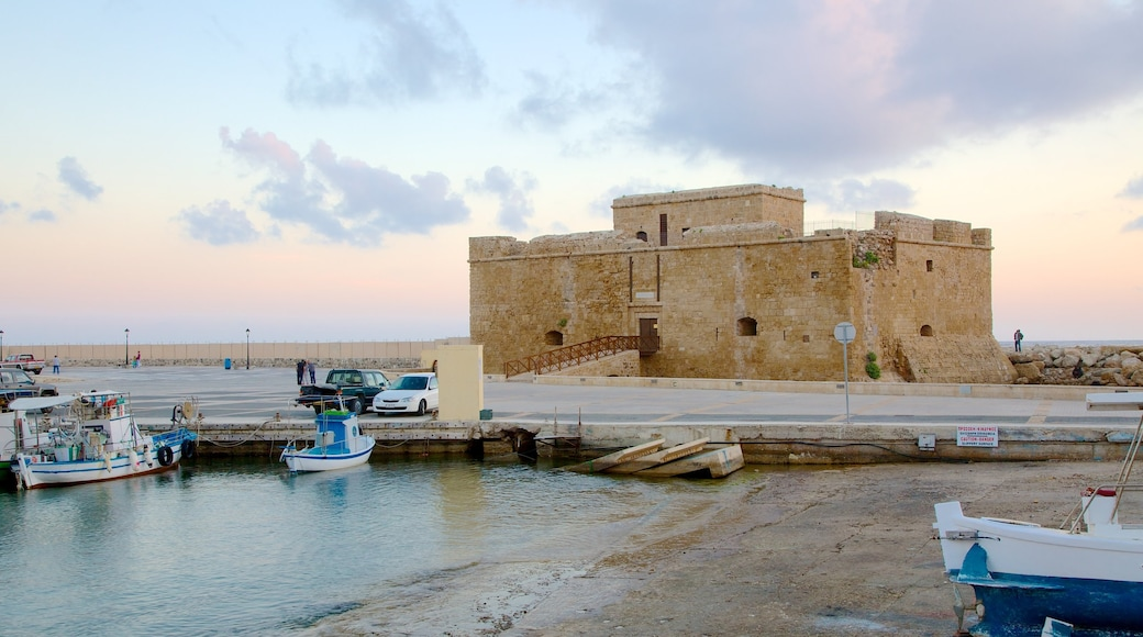 Paphos Harbour which includes a bay or harbor and a sunset