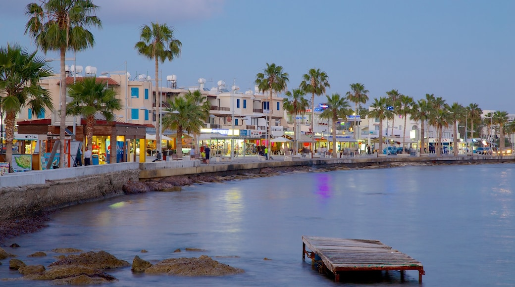 Paphos Harbour which includes a bay or harbour and a coastal town