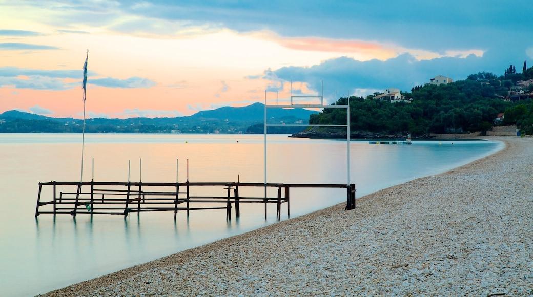 Barbati Beach which includes a sunset, general coastal views and a pebble beach