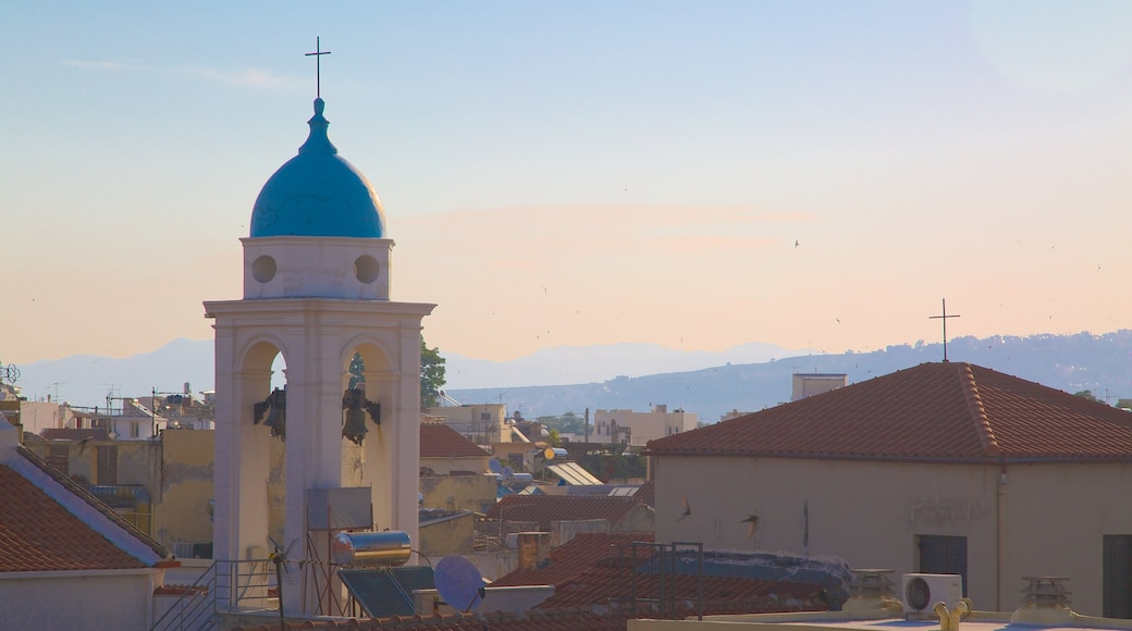Chania featuring a city, a sunset and a church or cathedral