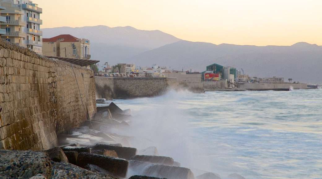 Heraklion Port featuring rocky coastline, a sunset and a marina