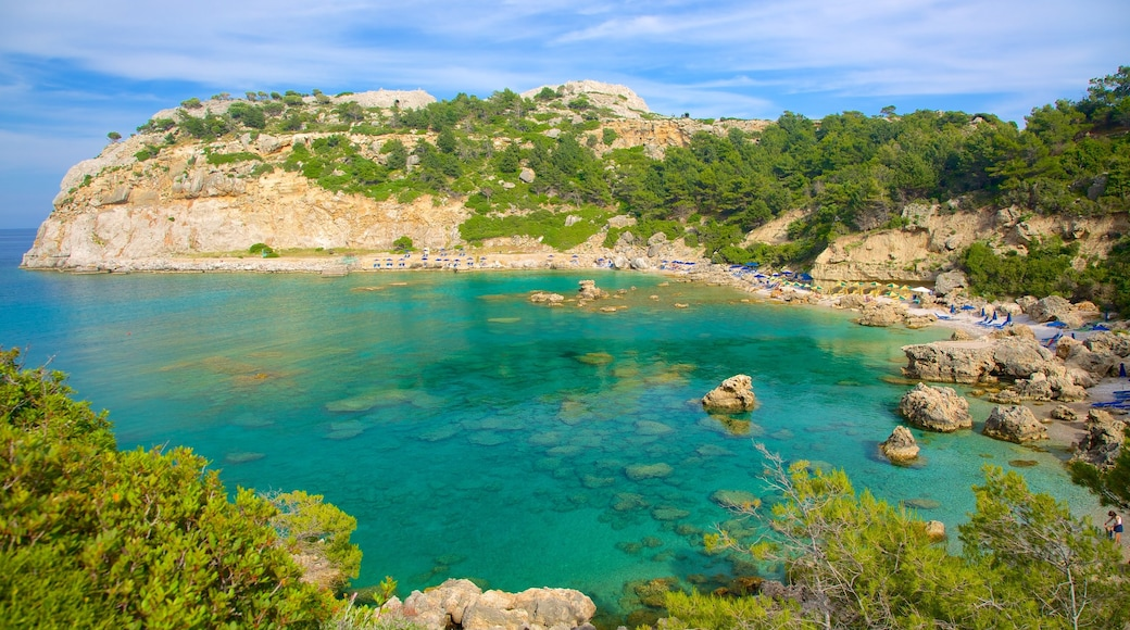Anthony Quinn Bay which includes rocky coastline