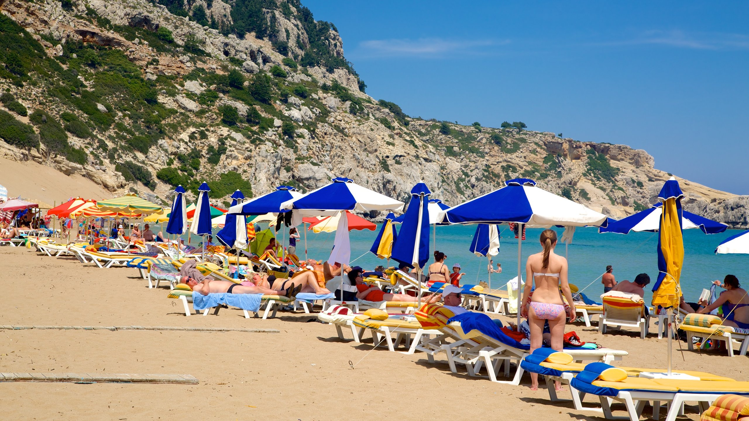 Sunbathe, swim, take part in watersports and walk to a hilltop monastery at this popular beach on the east coast of Rhodes.