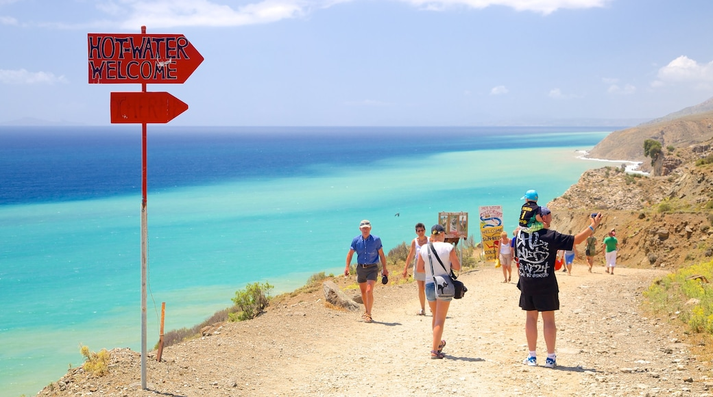 Therma Beach featuring hiking or walking, signage and general coastal views