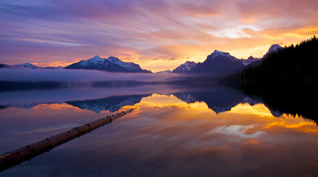Glacier National Park featuring a sunset and a lake or waterhole