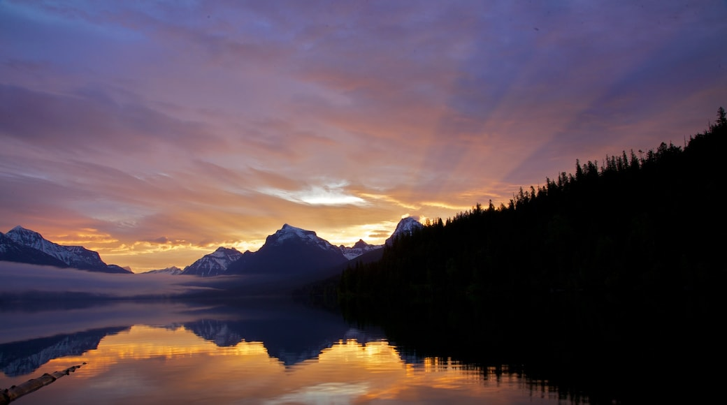 Glacier National Park showing a lake or waterhole and a sunset