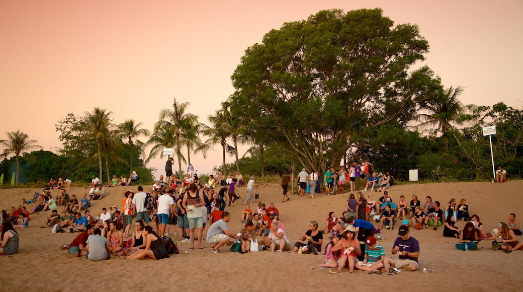 Mindil Beach showing a sunset and a beach as well as a large group of people