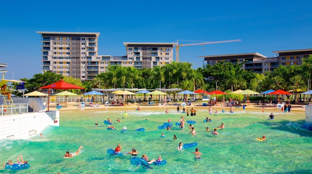 Darwin Waterfront which includes a pool and swimming as well as a large group of people