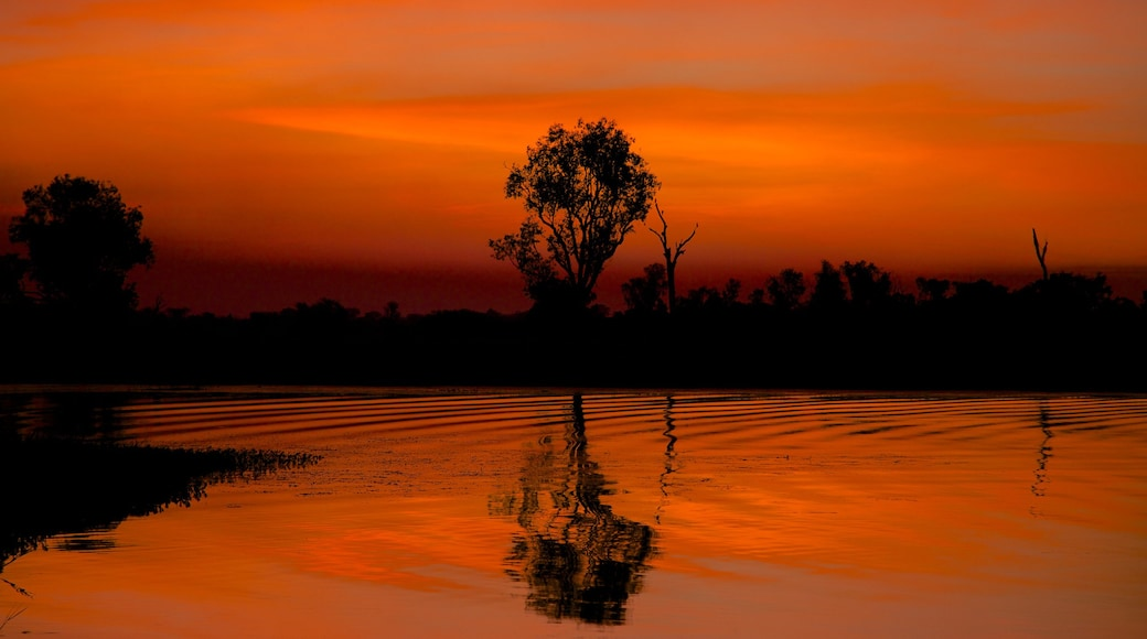 Kakadu National Park which includes a lake or waterhole and a sunset