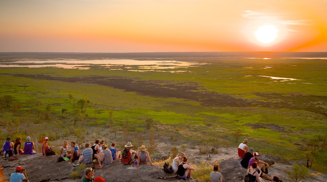 Ubirr showing a sunset as well as a large group of people