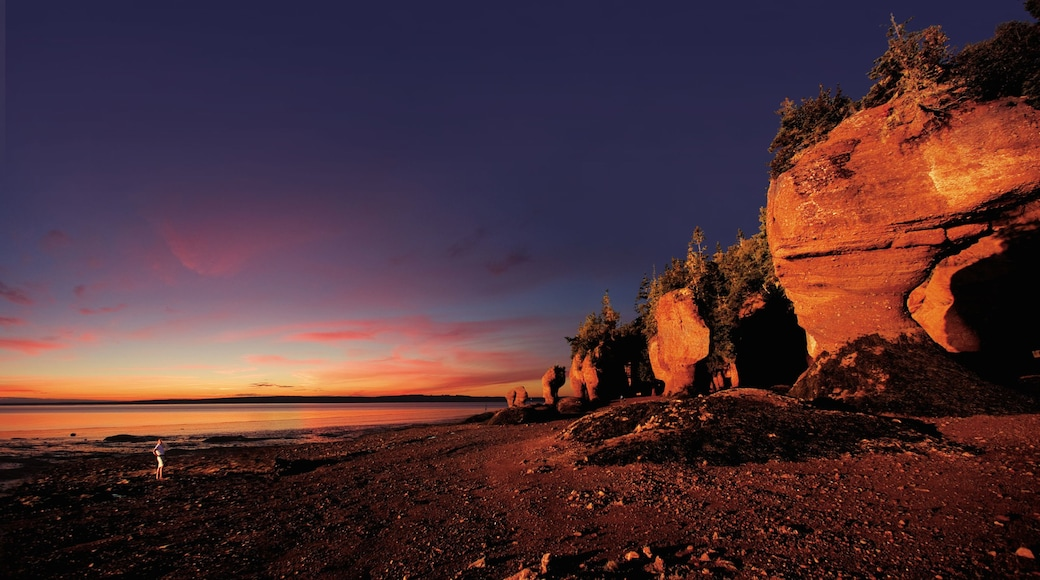 New Brunswick featuring a pebble beach and a sunset
