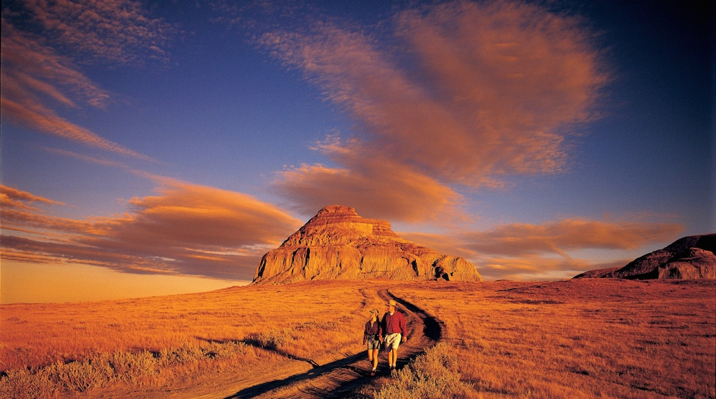 Saskatchewan which includes tranquil scenes, hiking or walking and a sunset