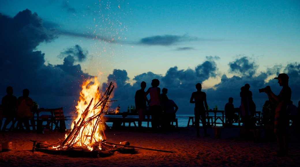 Gili Islands showing night scenes, a sunset and a sandy beach