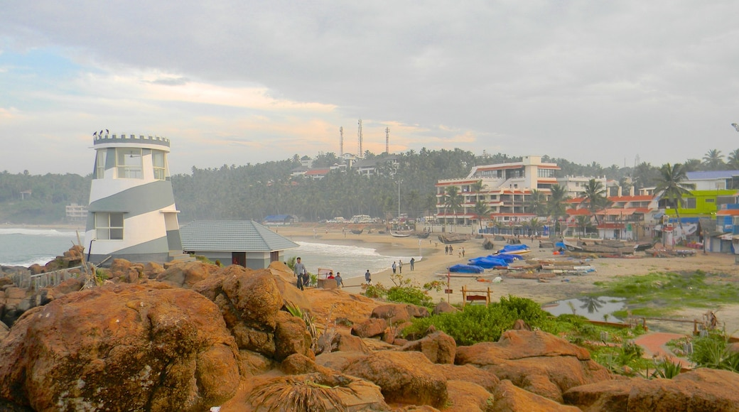 Kovalam featuring a lighthouse and a coastal town