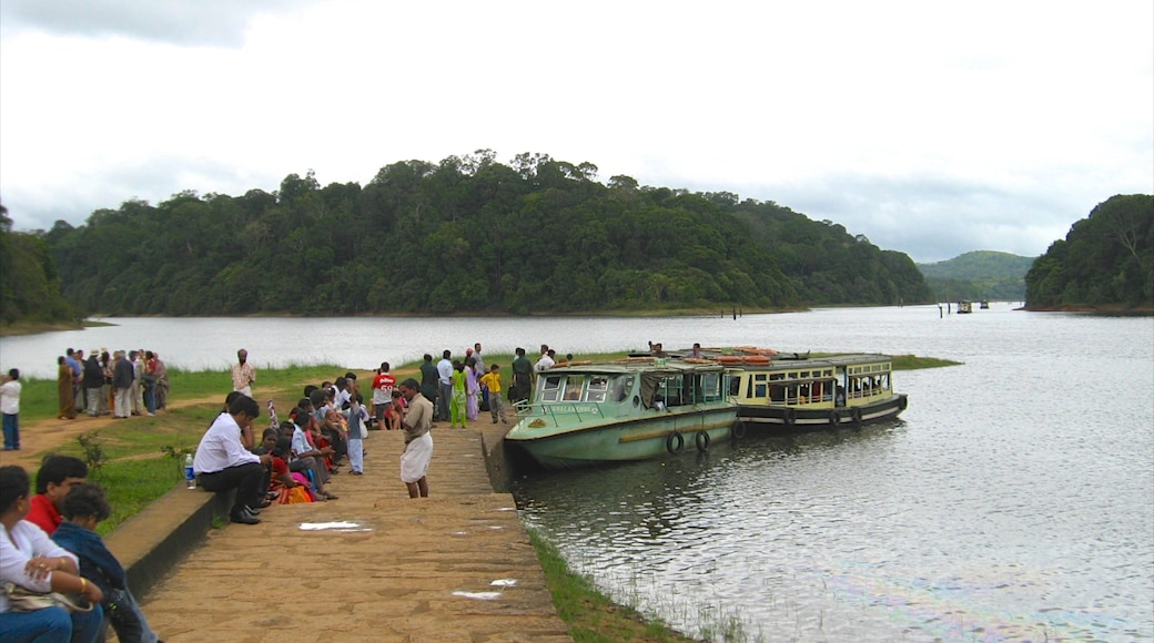 Thekkady featuring a lake or waterhole as well as a large group of people