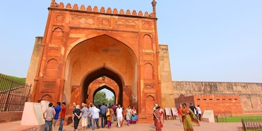 Agra Fort which includes heritage architecture as well as a large group of people