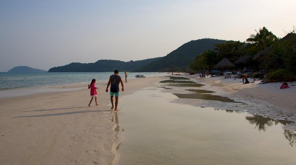 Sao Beach showing general coastal views and a sandy beach as well as a family
