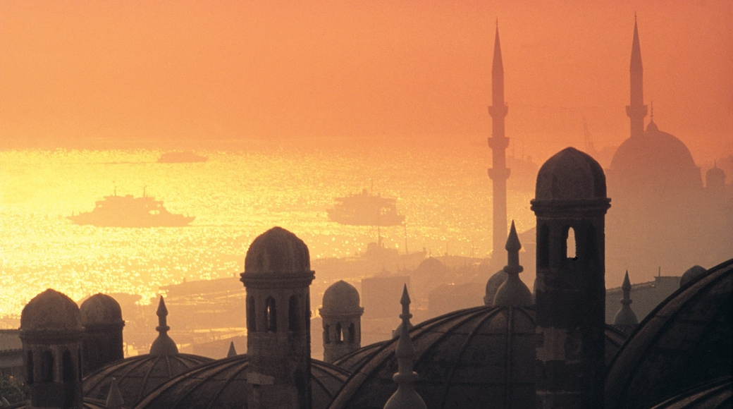 Istanbul showing a sunset, heritage architecture and mist or fog