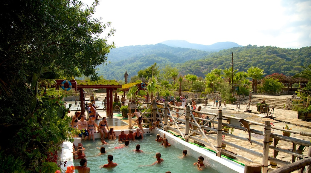 Dalyan featuring a pool as well as a large group of people