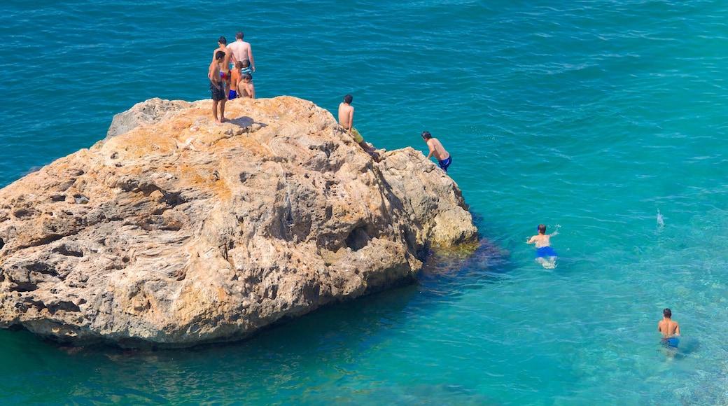 Konyaalti Beach Park featuring landscape views, rugged coastline and swimming