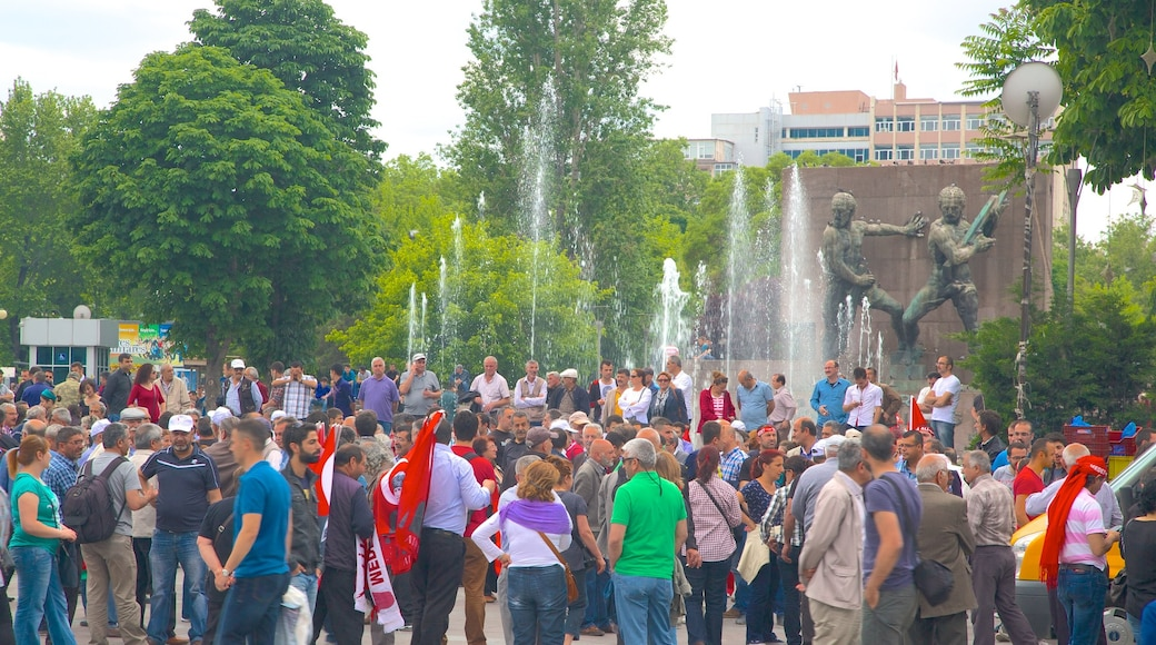 Kizilay Square showing street scenes as well as a large group of people