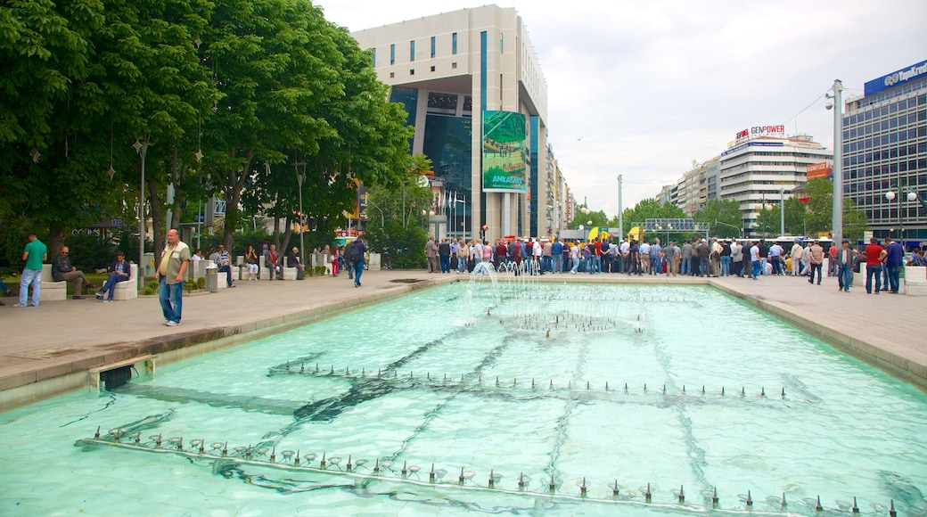 Kizilay Square which includes a fountain as well as a large group of people
