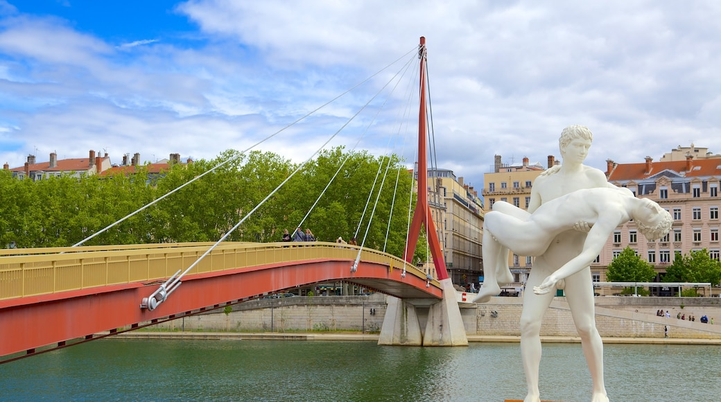 Bellecour Square which includes a statue or sculpture, a river or creek and a bridge