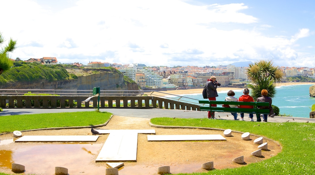 Biarritz Lighthouse showing a coastal town and a park