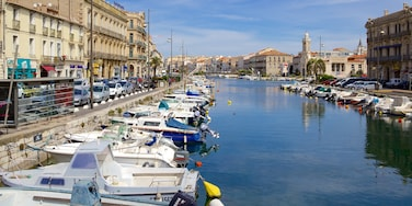 Sete featuring a river or creek, boating and a bay or harbour