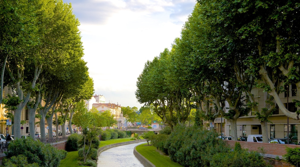 Perpignan featuring a river or creek and a garden