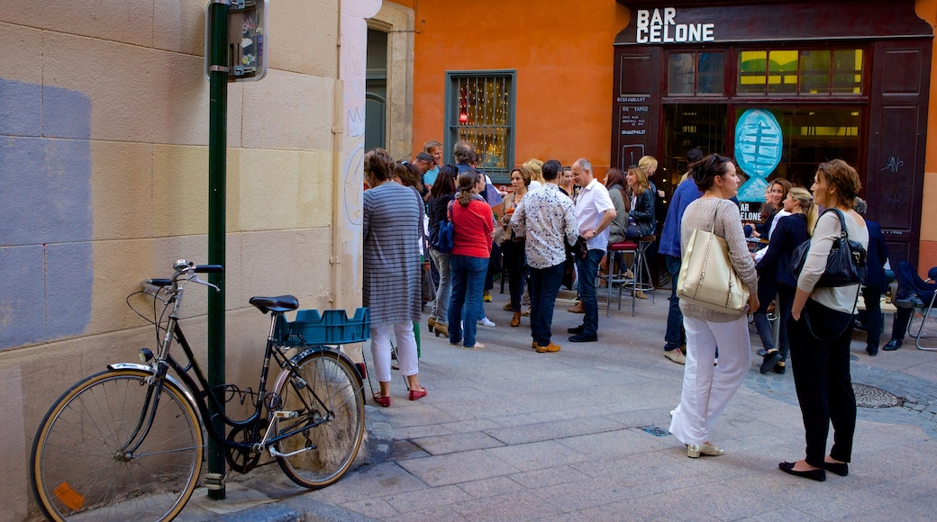 Perpignan which includes street scenes as well as a large group of people