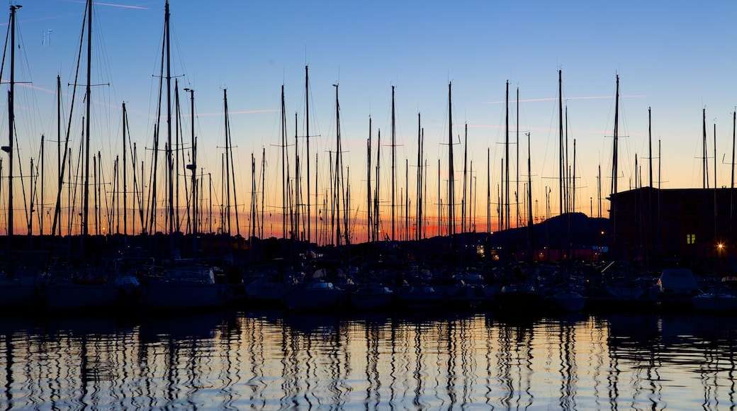 Port of Toulon which includes a sunset, general coastal views and a marina
