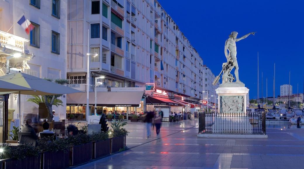 Marina de Toulon qui includes square ou place, scènes de nuit et statue ou sculpture
