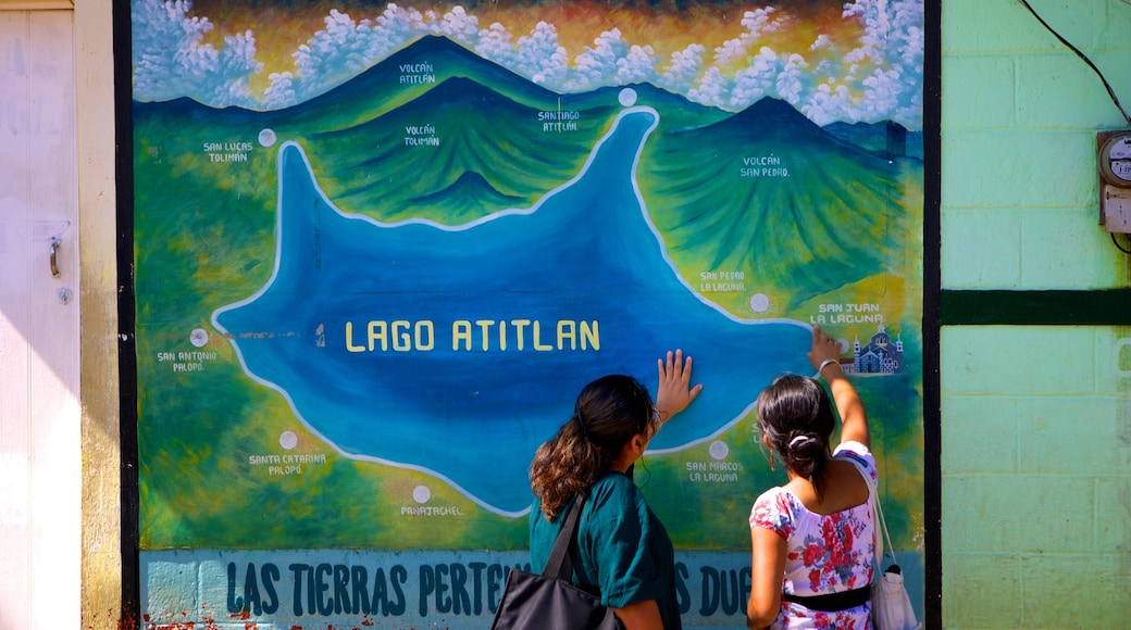 San Juan La Laguna which includes signage as well as a small group of people