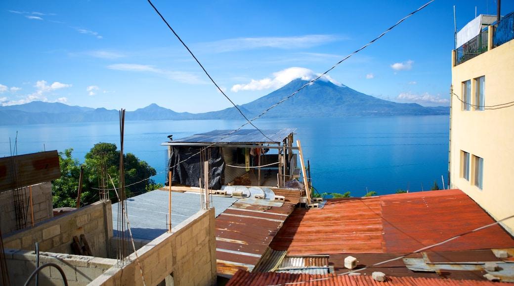 Santa Cruz La Laguna which includes a lake or waterhole and a small town or village