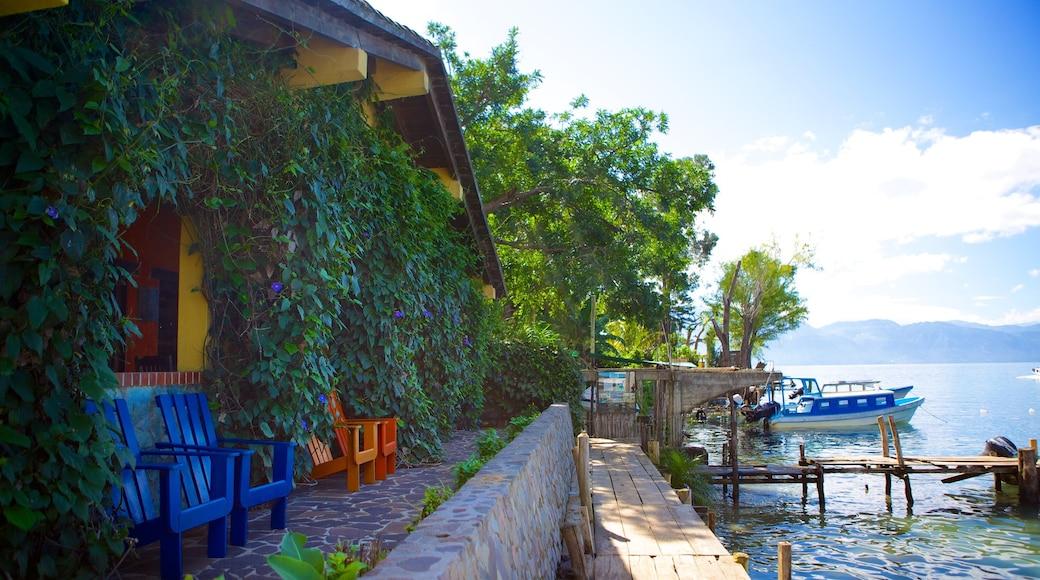 Santa Cruz La Laguna which includes a house and general coastal views