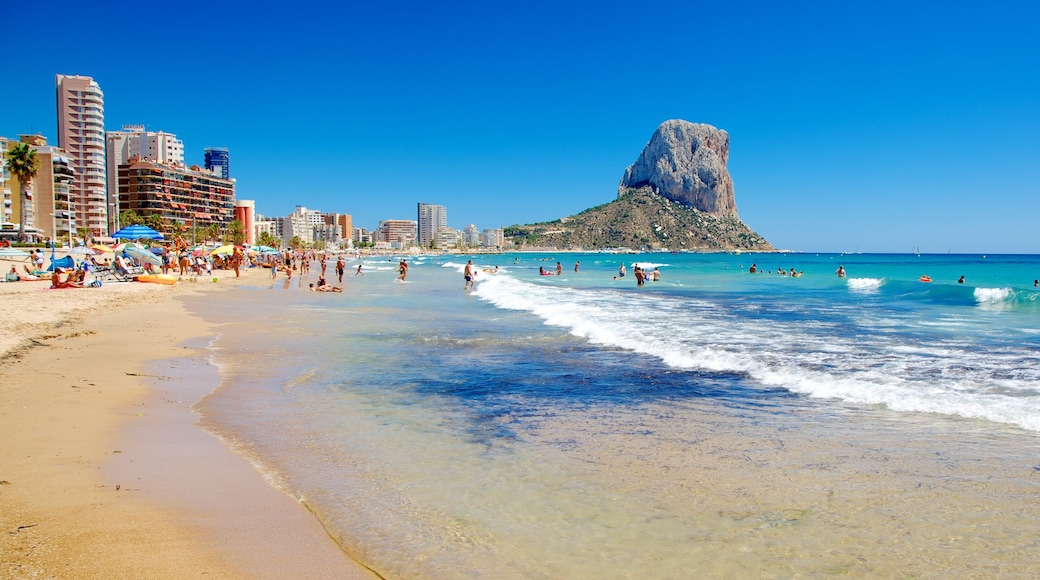 Spain featuring a beach and landscape views as well as a large group of people