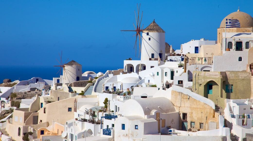 Oia which includes a windmill and a coastal town