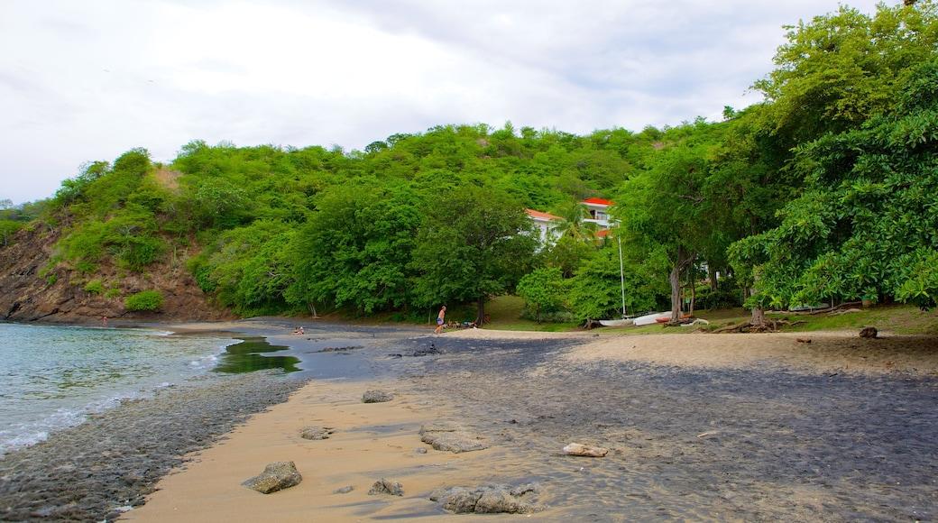 El Ocotal featuring a sandy beach and a pebble beach