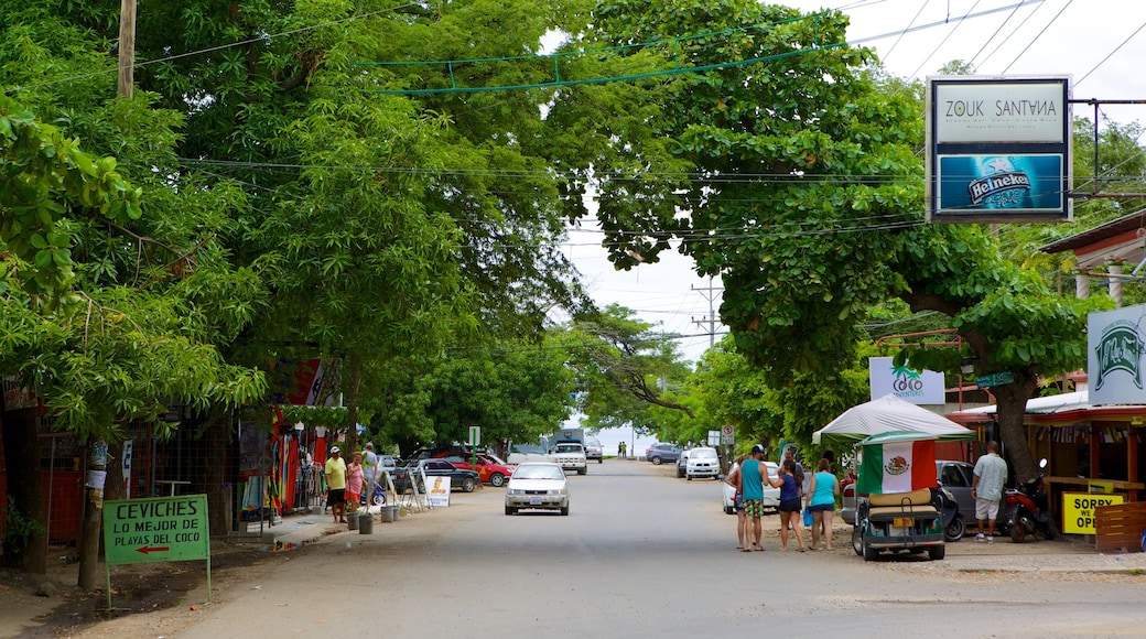 Coco Beach featuring street scenes