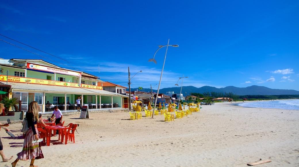 Barra da Lagoa Beach showing a sandy beach and landscape views