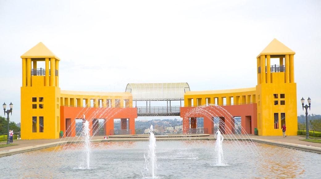 Parque Tanguá caracterizando arquitetura moderna, uma fonte e um lago