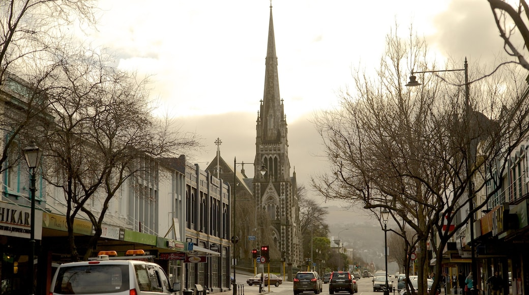 Dunedin showing a church or cathedral, street scenes and mist or fog