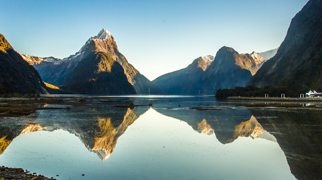 Milford Sound showing a river or creek and mountains